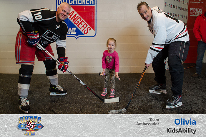 Olivia from KidsAbility helps with a captain's puck drop