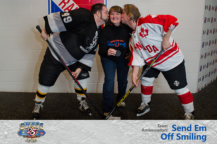 Team ambassador for Send Em Off Smiling gets a kiss during a captain's puck drop